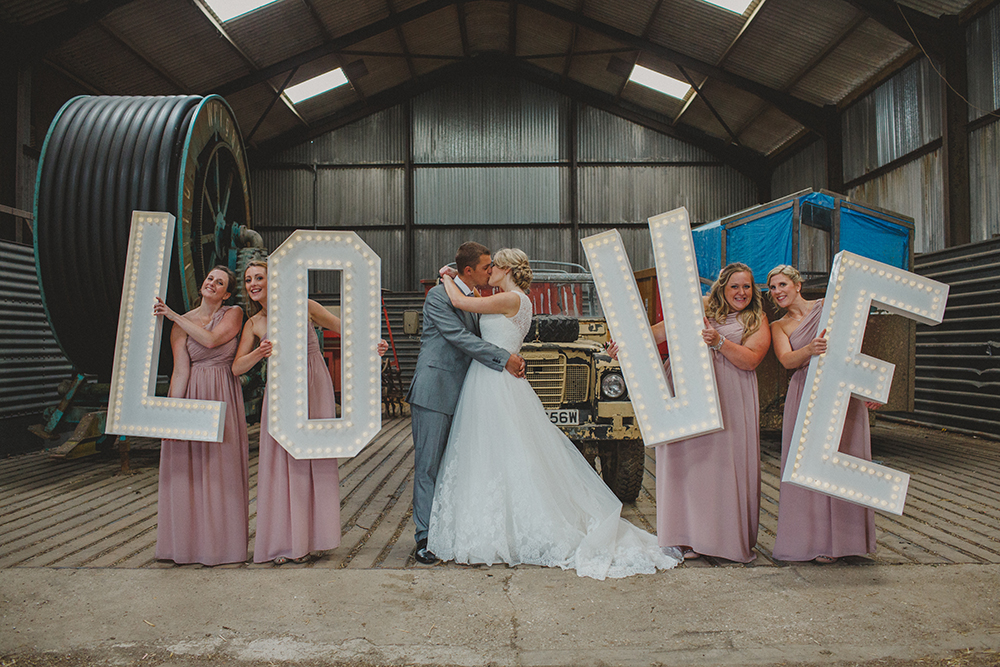 love light up letters held up by bridesmaids